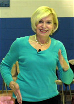 Kathy Poelker showing movement with hands